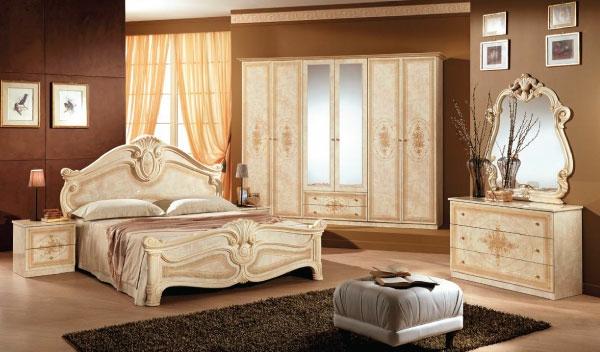 luksozna spalnia obzavedena v prelivashti svetli tonove sachetani s krasiva darvorezba