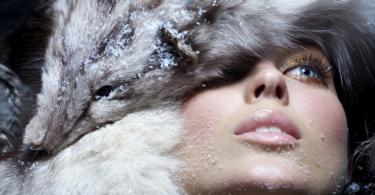 Model dressed in fur. Focus is sharper on animal head.
